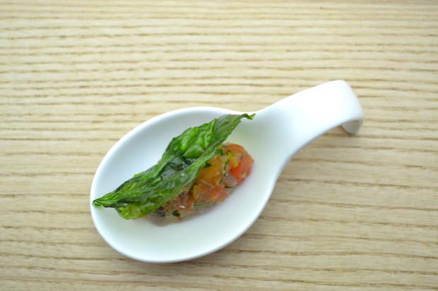 Fish tartar with mint leaf at Riff